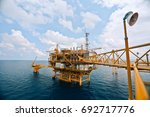 offshore oil rig in the middle... | Shutterstock . vector #692717776