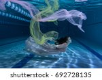 swimmer plays underwater with a ... | Shutterstock . vector #692728135