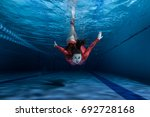 swimmer dives into the pool ... | Shutterstock . vector #692728168