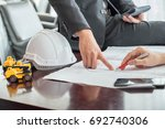 architect and construction... | Shutterstock . vector #692740306