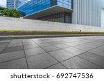 empty brick floor with modern... | Shutterstock . vector #692747536