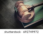 gavel and green legal book on