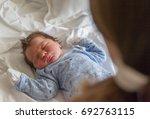little cute newborn baby boy is ... | Shutterstock . vector #692763115