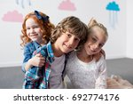 portrait of adorable happy kids ... | Shutterstock . vector #692774176