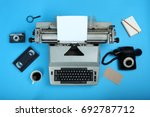 old typewriter with a sheet of... | Shutterstock . vector #692787712