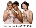 beautiful young smiling women... | Shutterstock . vector #692794546