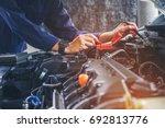 hands of car mechanic  working... | Shutterstock . vector #692813776