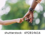 cropped view of african...   Shutterstock . vector #692814616