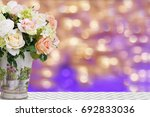 roses in vintage pot with... | Shutterstock . vector #692833036
