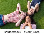 high angle view of young... | Shutterstock . vector #692846326