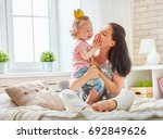 happy loving family. mother and ... | Shutterstock . vector #692849626