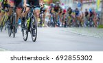 athletes in a cycling... | Shutterstock . vector #692855302