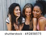 close up shot of three young... | Shutterstock . vector #692858575