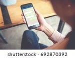 closeup woman hand holding... | Shutterstock . vector #692870392