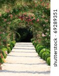 Blooming Rose Arch In The...