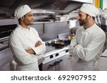 chefs interacting with each... | Shutterstock . vector #692907952