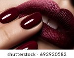 macro lips nail burgundy color... | Shutterstock . vector #692920582