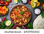 cooking mexican taco with meat... | Shutterstock . vector #692950342