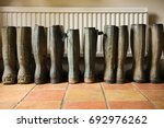 wellington boots by the back... | Shutterstock . vector #692976262