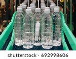 water bottling in the... | Shutterstock . vector #692998606