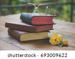rose and the old book and... | Shutterstock . vector #693009622
