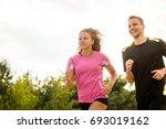 couple running in a park.... | Shutterstock . vector #693019162