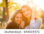 portrait of two friends   ... | Shutterstock . vector #693019372