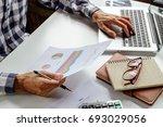 businessman analyzing... | Shutterstock . vector #693029056