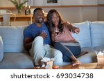 black african couple watching... | Shutterstock . vector #693034738