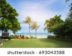 beach chairs with table on the...   Shutterstock . vector #693043588