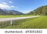 little boy beside street... | Shutterstock . vector #693051832