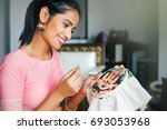 young beautiful indian woman... | Shutterstock . vector #693053968