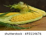 Three Fresh Corn Cob On Wooden...