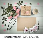 Stock photo magnolia pink roses with blank sheet paper for greeting text and gift box coffee cup on 693172846
