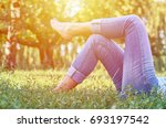 a young girl lying on the grass ... | Shutterstock . vector #693197542