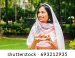 young beautiful indian woman... | Shutterstock . vector #693212935