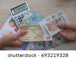 people  exchanging money ... | Shutterstock . vector #693219328