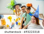 family carving pumpkins | Shutterstock . vector #693223318