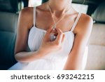 girl in a white dress with a ... | Shutterstock . vector #693242215