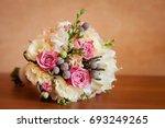 delicate wedding bouquet on...   Shutterstock . vector #693249265