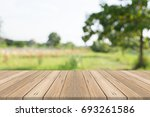 wood table top on nature green... | Shutterstock . vector #693261586