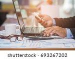 a businessman analyzing... | Shutterstock . vector #693267202