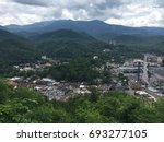 View of city of Gatlinburg with mountains in background in Gatlinburg, TN- June 5, 2015