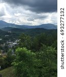 View of Gatlinburg with clouds and mountains in background in Gatlinburg, TN- June 5, 2015