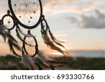 dream catcher on the sunset... | Shutterstock . vector #693330766