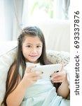 girl using mobile phone ... | Shutterstock . vector #693337876