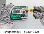 hvac technician repairing... | Shutterstock . vector #693349126