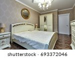 bedroom with a beautiful... | Shutterstock . vector #693372046