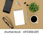 notebook on brown background... | Shutterstock . vector #693386185
