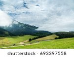 green meadow and mountains in... | Shutterstock . vector #693397558